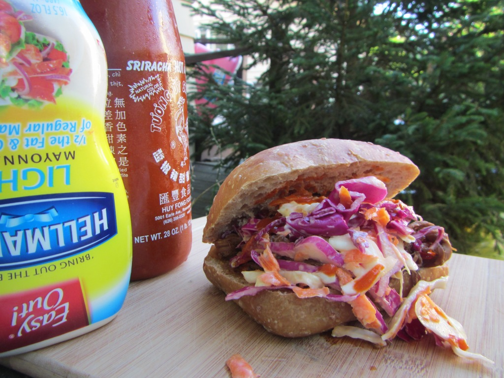 Pulled pork and coleslaw on a whole-wheat ciabatta roll.