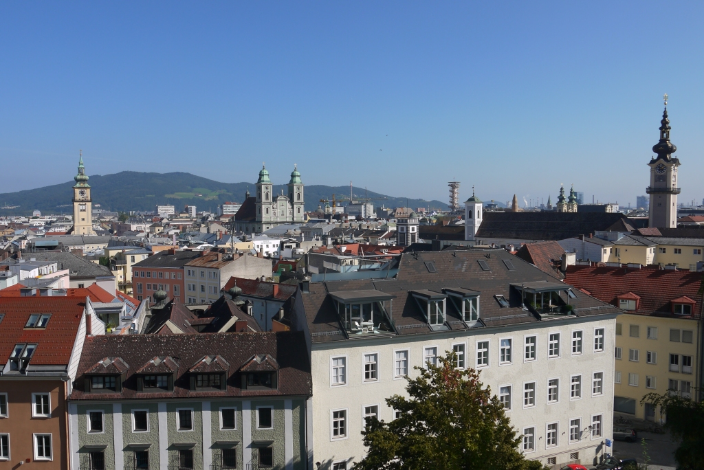 The skyline of the Linz Altstadt on a sunny day.